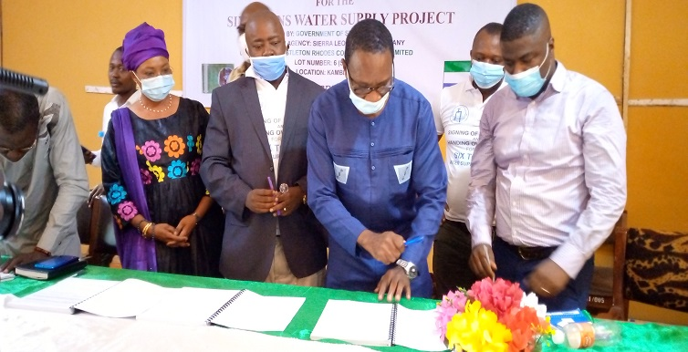 signing of the six towns project contract agreement and hand over site to contractors